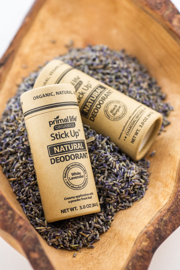 2 Stick Up natural deodorants laying in dried lavender